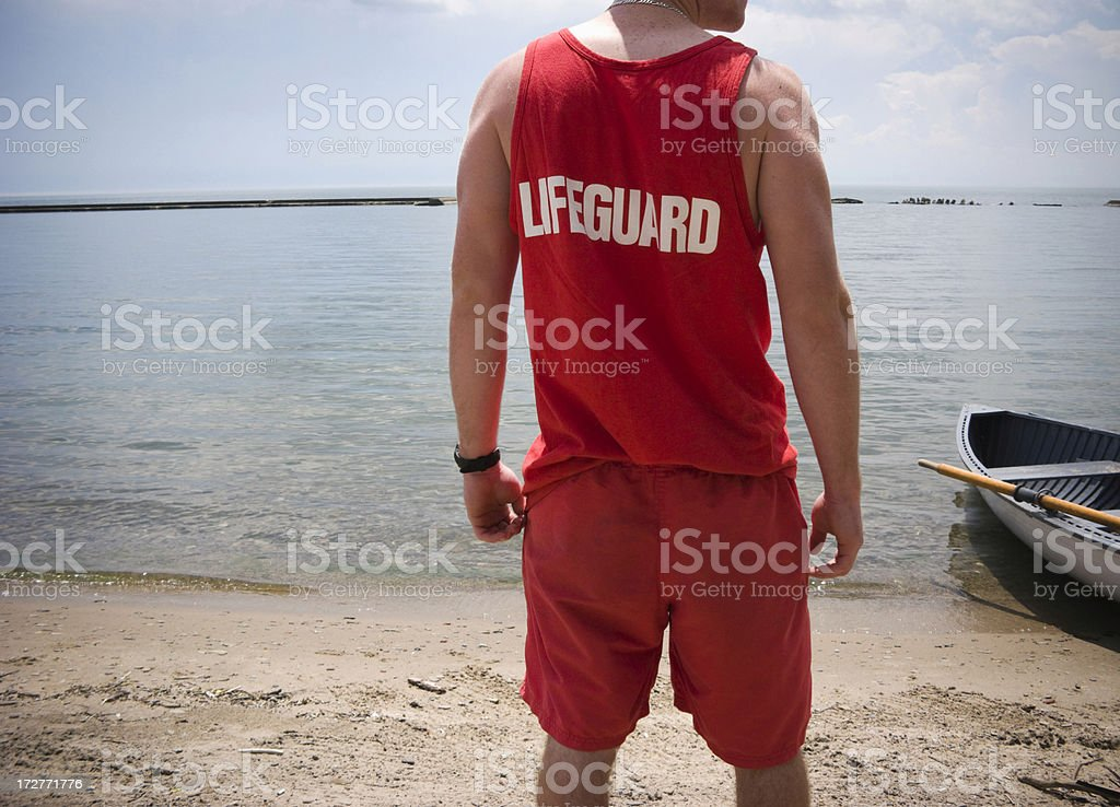 Lifeguard watches the water royalty-free stock photo