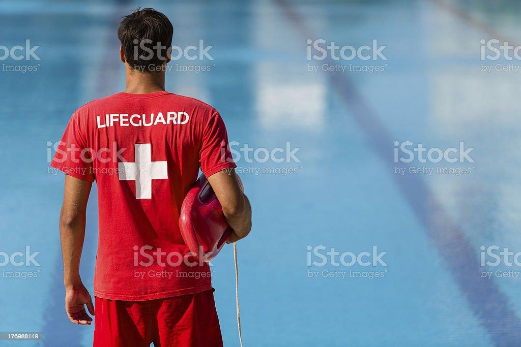 Lifeguard watching swimming pool stock photo