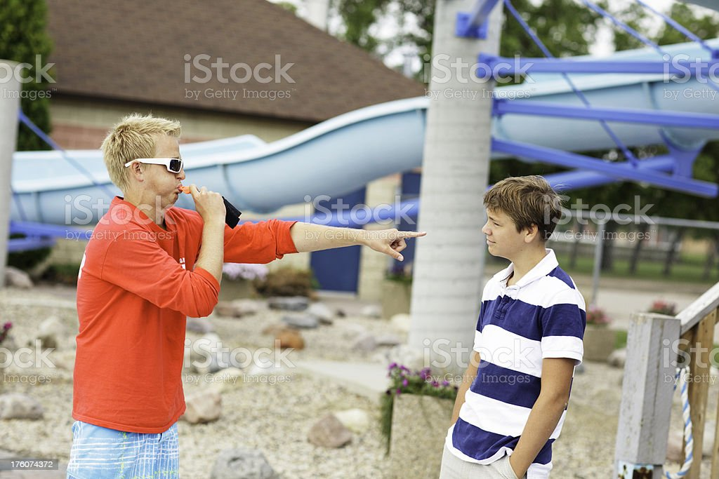 Lifeguard Yelling at Teenager royalty-free stock photo
