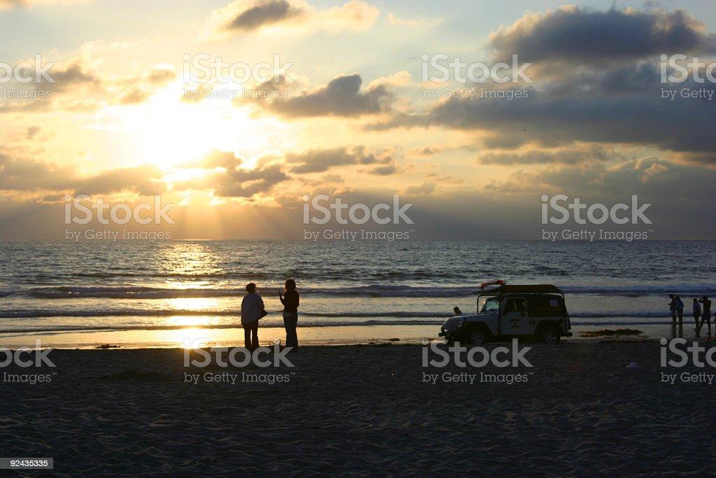 Lifeguards at sunset royalty-free stock photo