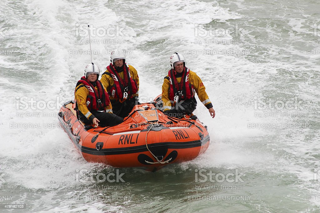 RNLI Lifeguards in action royalty-free stock photo