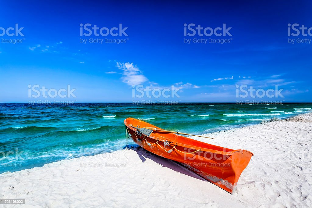 Lifeguard's rescue boat on the beach stock photo