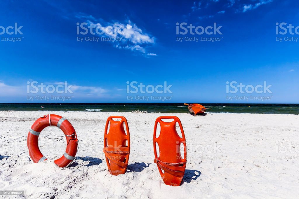 Lifeguard's rescue equipment on the beach stock photo