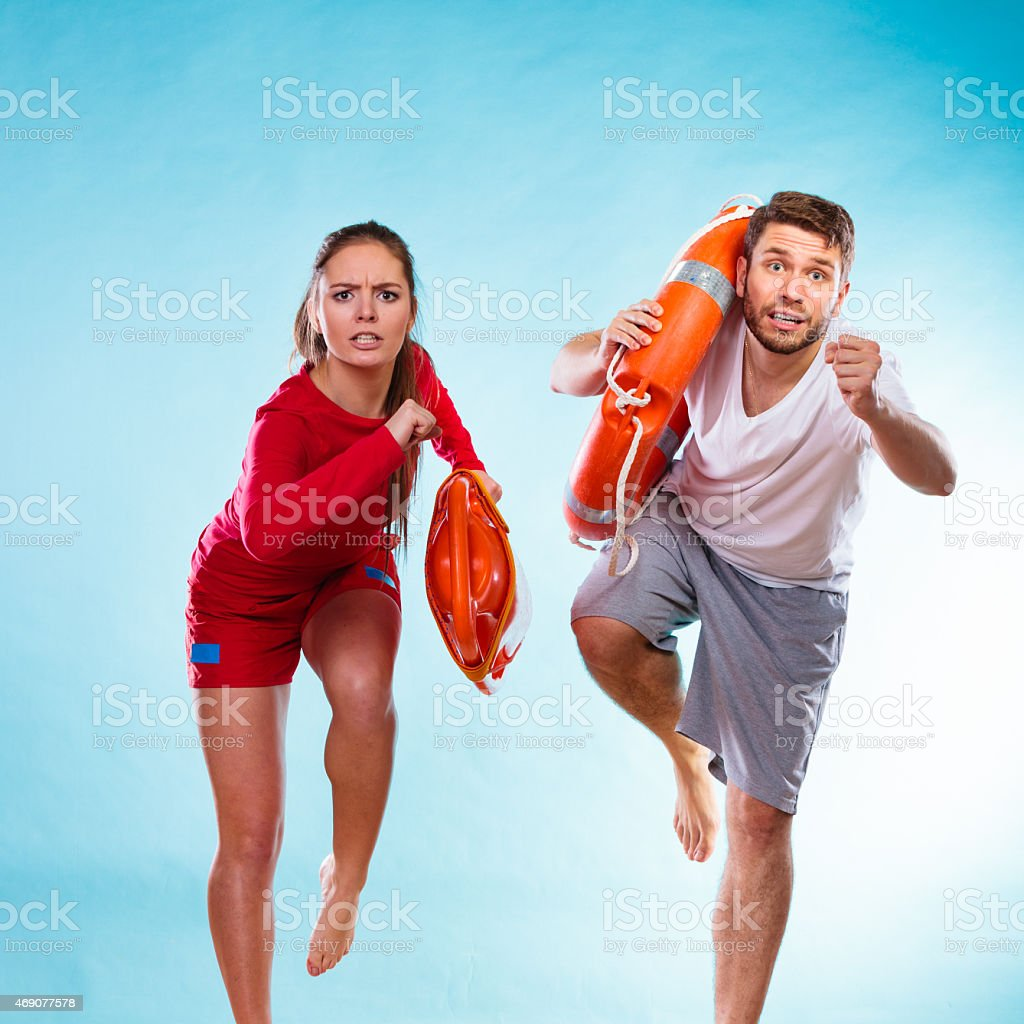 lifeguards running with equipment stock photo