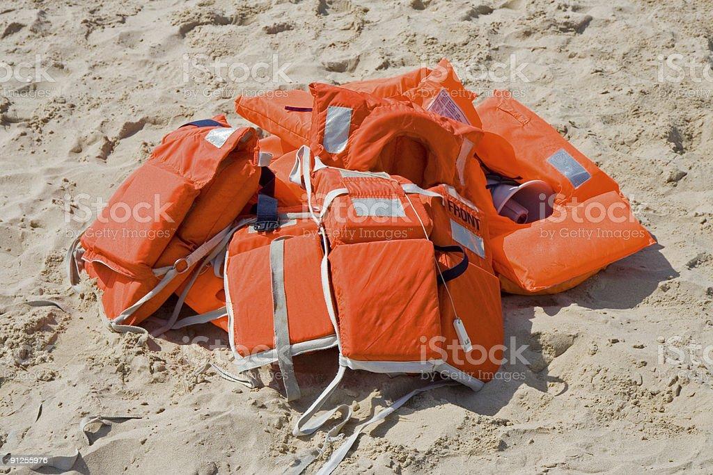Life-jackets on the beach royalty-free stock photo