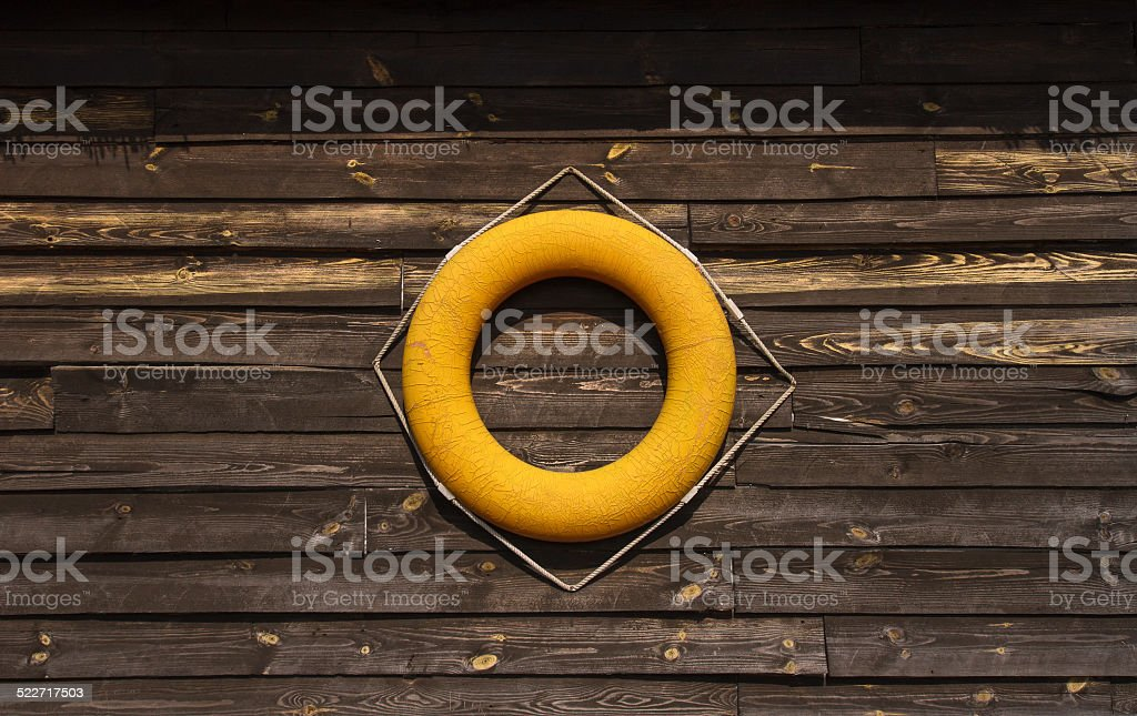 Lifering on a wooden wall stock photo