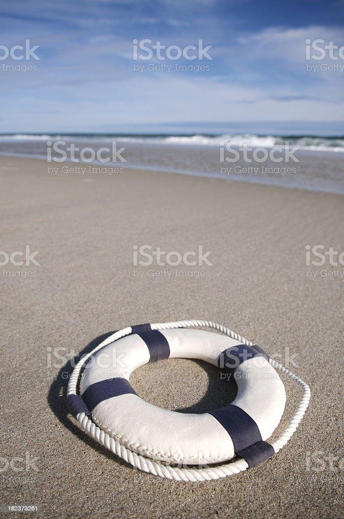 Lifesaver Sits on Empty Summer Beach stock photo