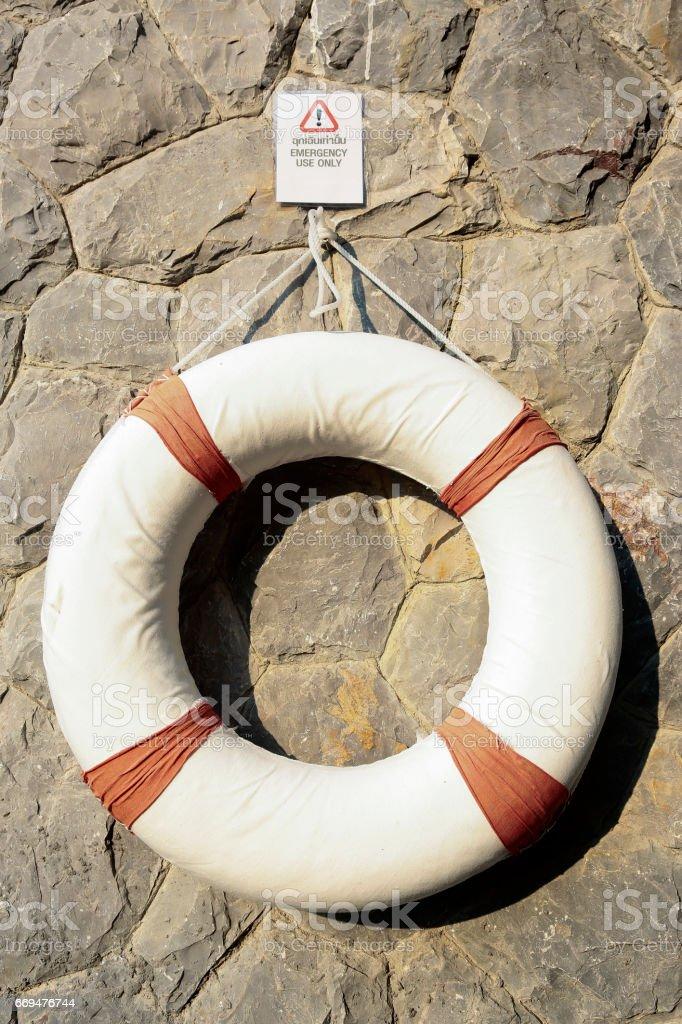 Life-saving equipment hanging on wall stock photo