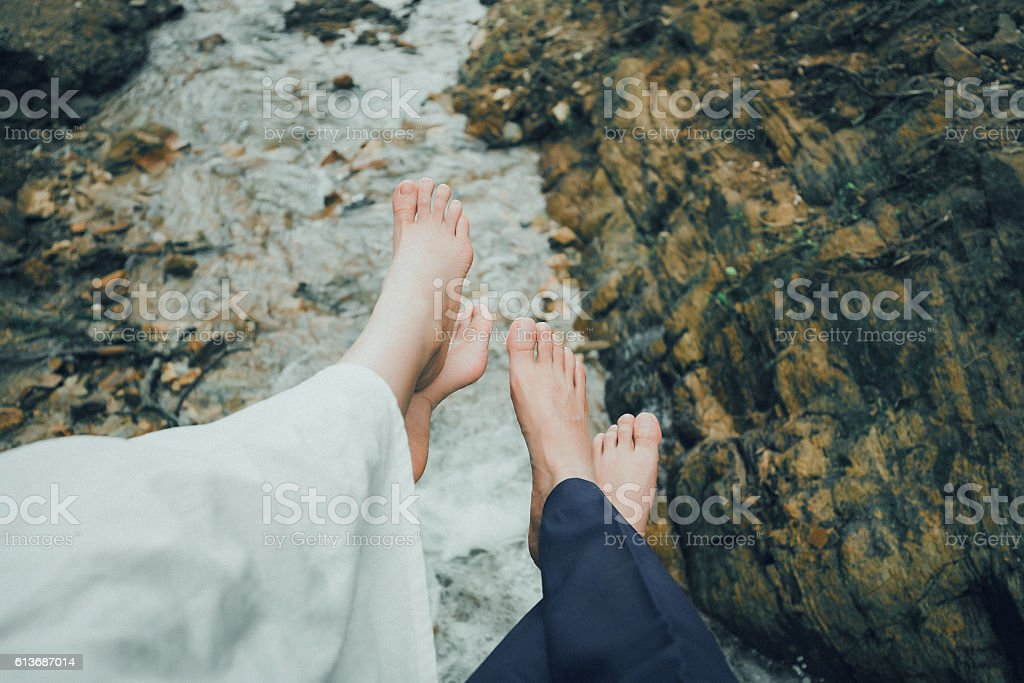 Lifestyle. Beautiful couple legs in small river stock photo