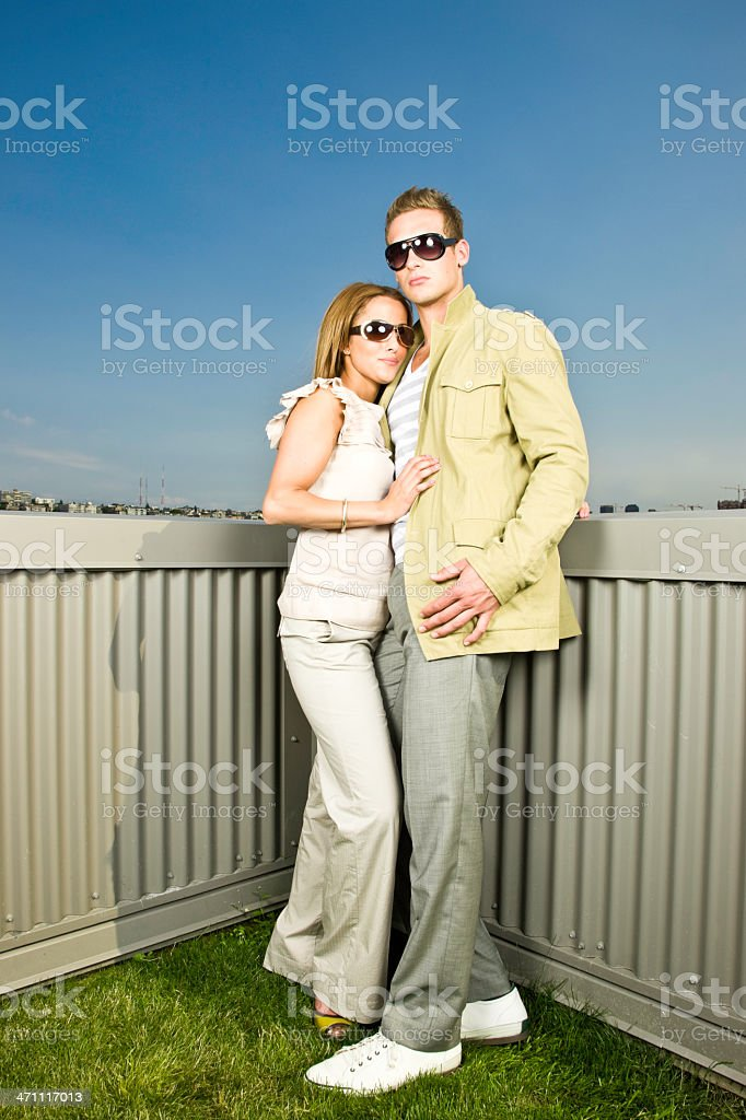 Lifestyle Couple on Grass Rooftop royalty-free stock photo