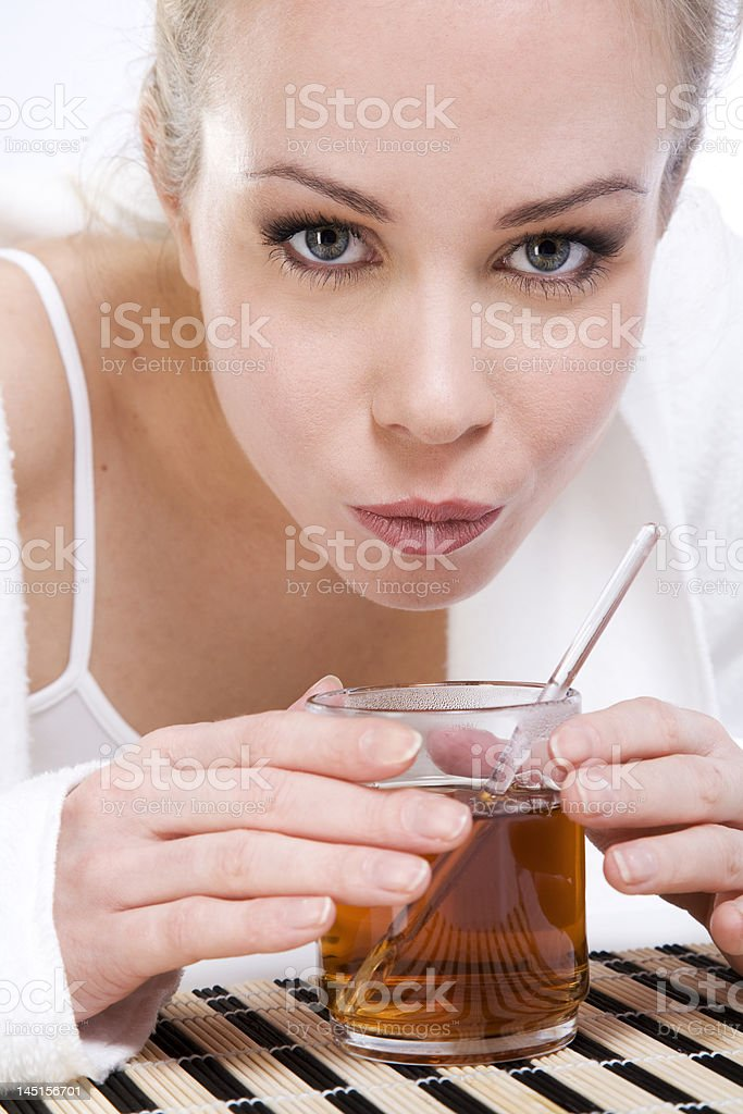 Lifestyle model drinking hot tea royalty-free stock photo