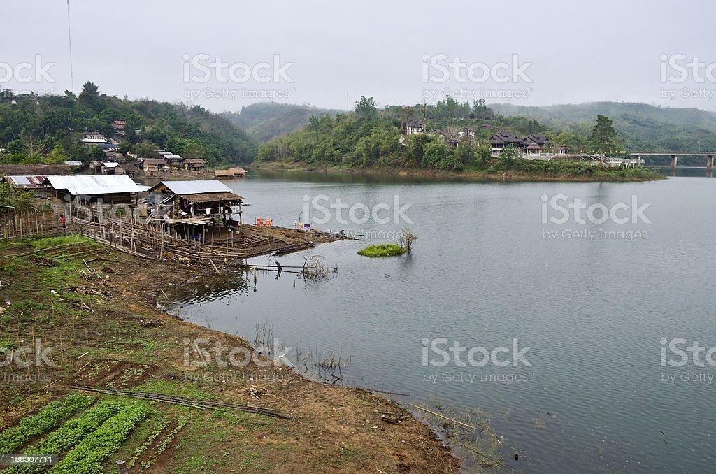 Lifestyle  Mon, waterfront homes, mountain, songkalia river royalty-free stock photo