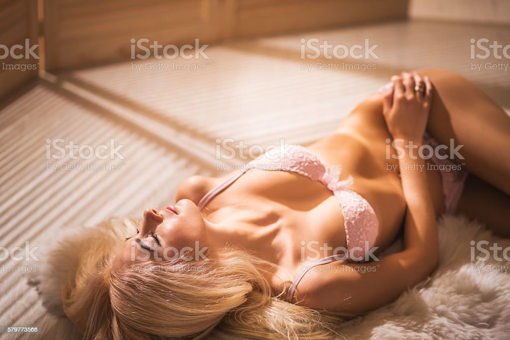 Lifestyle relaxation concept. woman relaxing in warm lamp light. stock photo