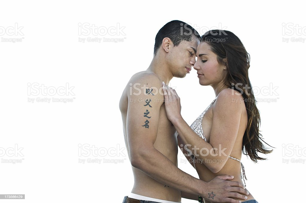 Lifestyle - Sexy couple caressing on the beach royalty-free stock photo