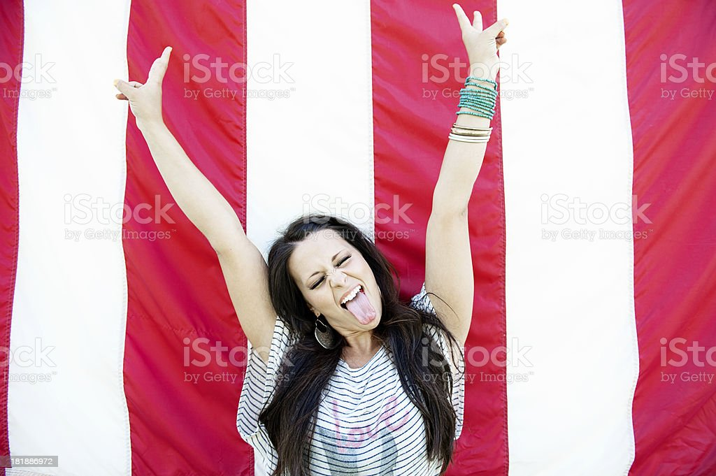 Lifestyles: Beautiful Young Woman Standing By An American Flag royalty-free stock photo