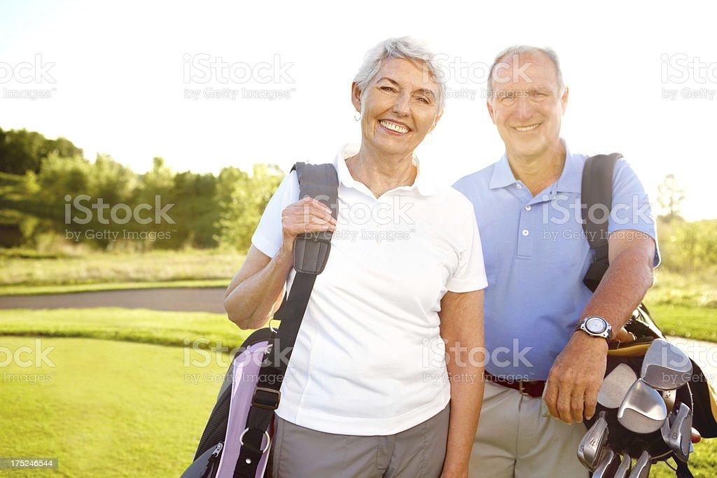 Lifetime golfing partners royalty-free stock photo