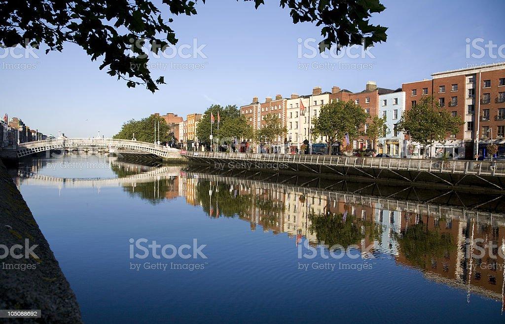 Liffey river with Ha'penny Bridge stock photo