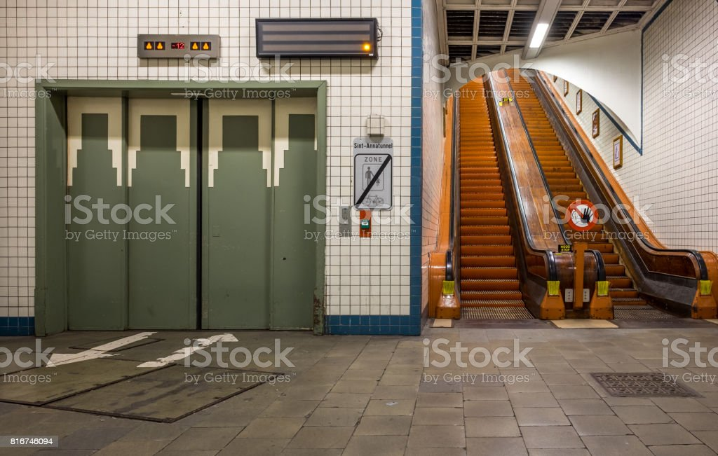 Lift and wooden escalators in the Sint-Anna Pedestrian Tunnel in Antwerp, Belgium. stock photo