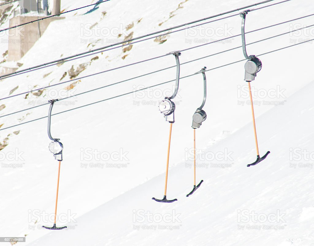 lift on snowy mountain peaks stock photo