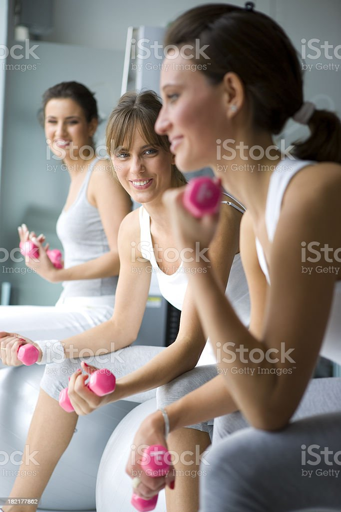 Lifting dumbbell royalty-free stock photo