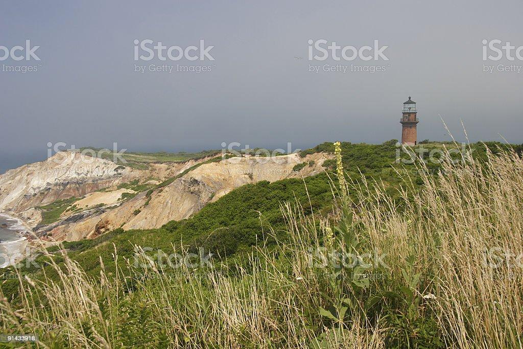 Lifting fog over Gay Head lighthouse on Martha's Vineyard beach royalty-free stock photo