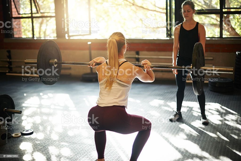 Lifting her way to gorgeous glutes stock photo
