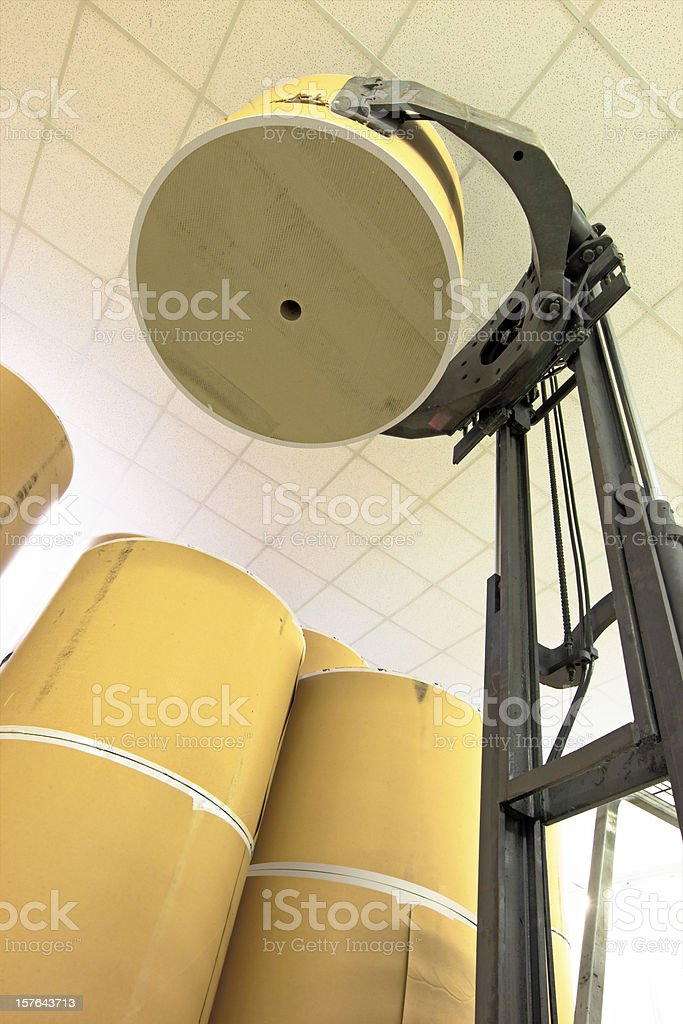 Lifting spools of paper royalty-free stock photo