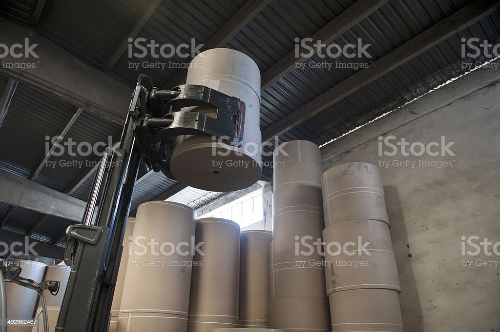 Lifting spools of paper stock photo