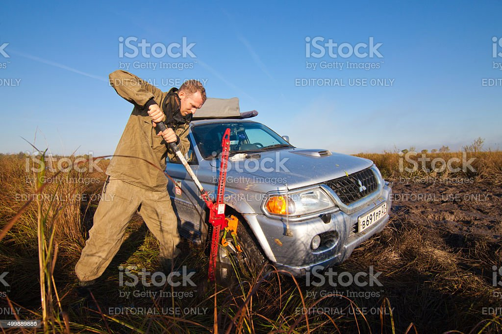 Priamursky, Russia - October 5, 2014: Lifting stuck car stock photo