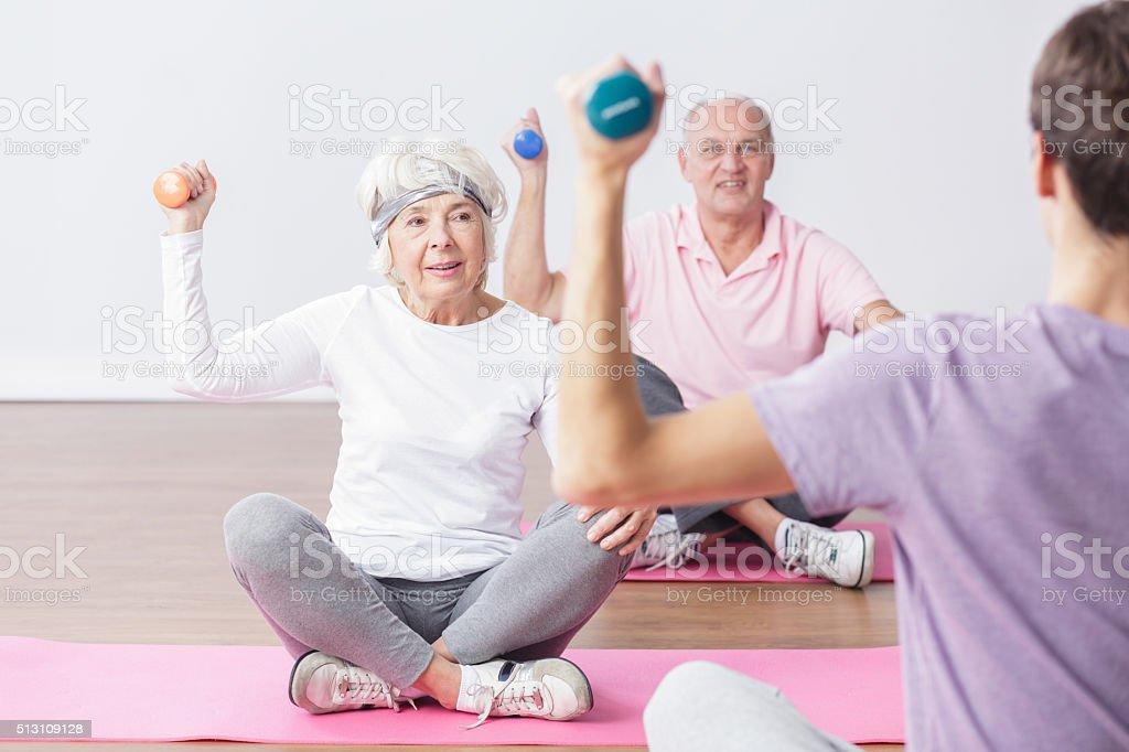 Lifting the dumbbells stock photo