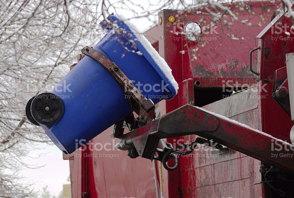 Lifting the trash stock photo