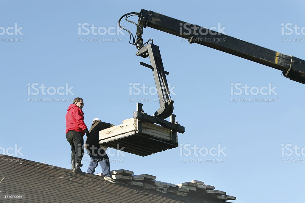 Lifting up the shingles royalty-free stock photo