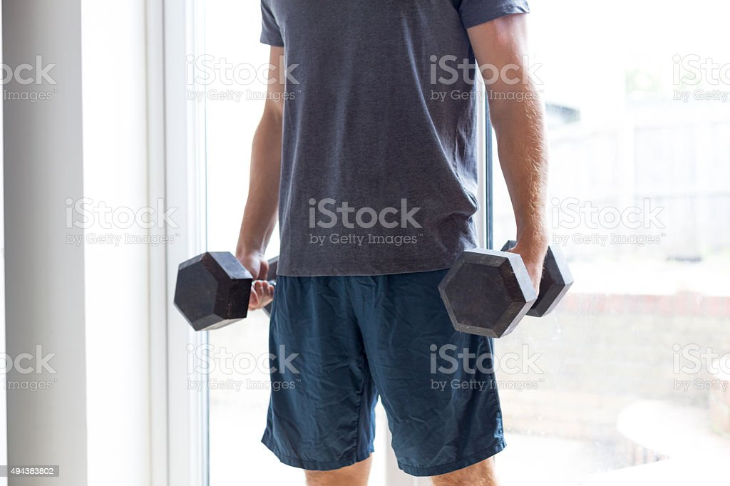 Lifting weights at home stock photo