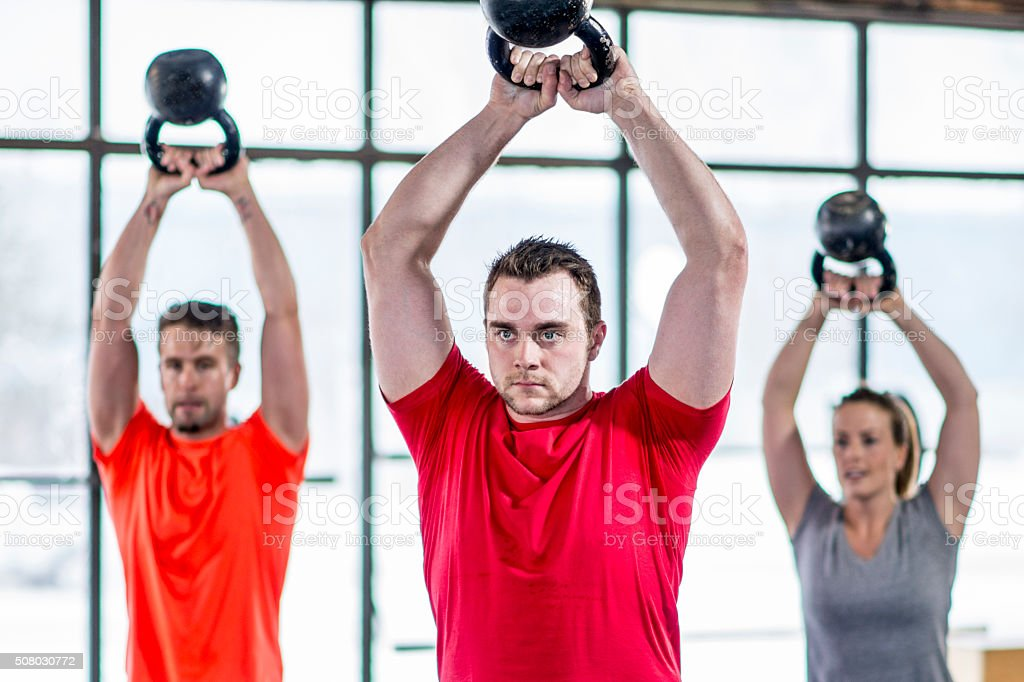 Lifting Weights at the Gym stock photo