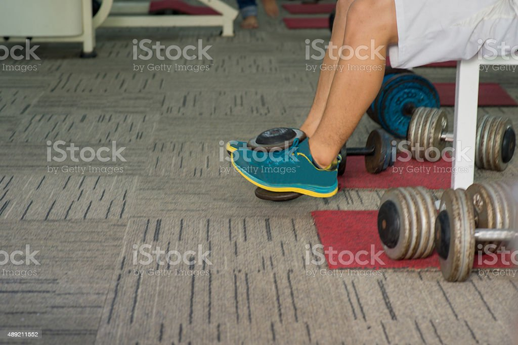 Lifting weights with legs stock photo
