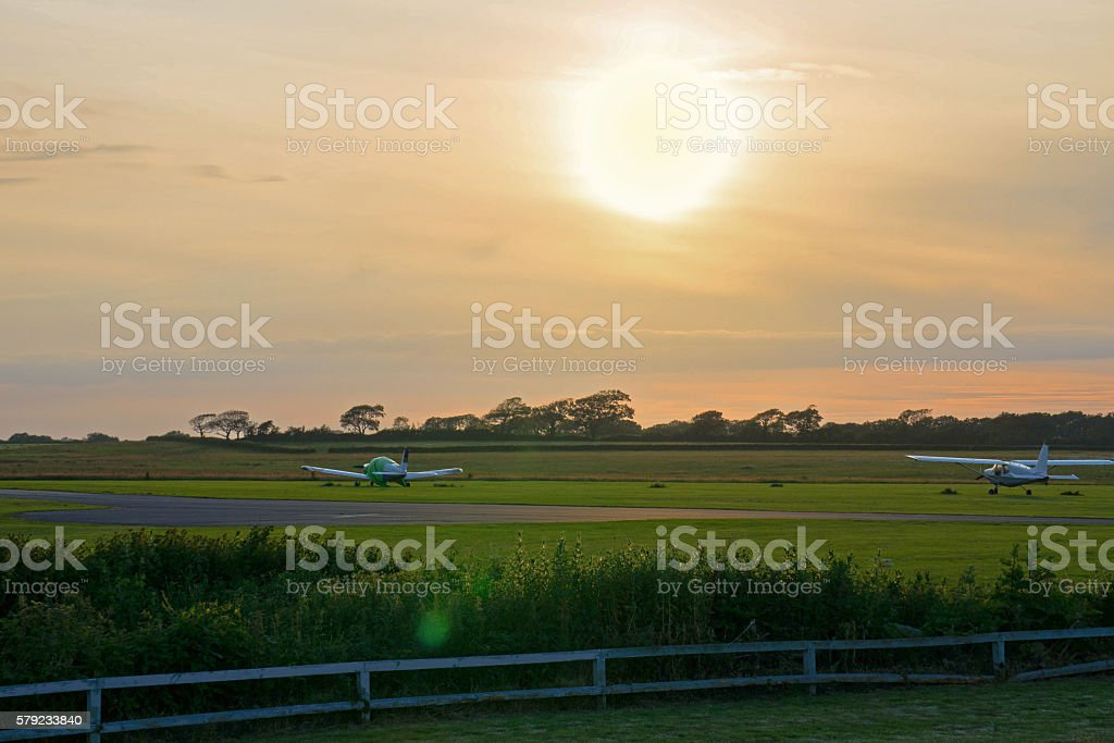 Light Aircraft at Sunset stock photo