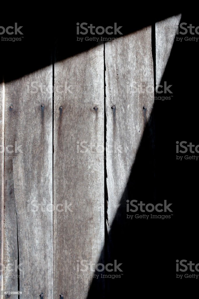 light and shadow on old wood background stock photo