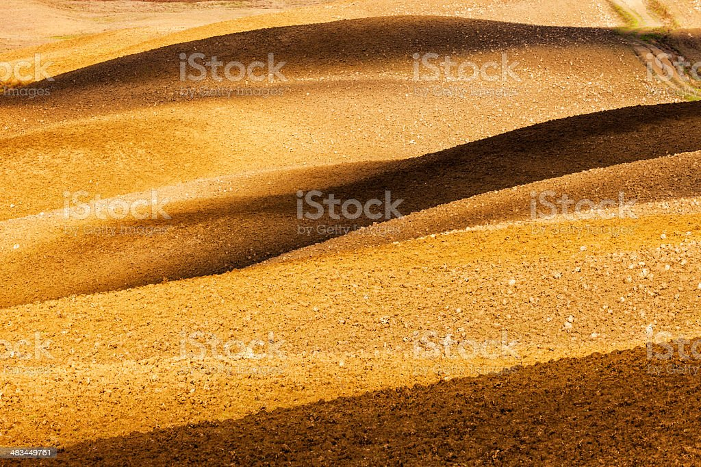 Light and Shadow Play on Rolling Hills, Tuscany, Italy royalty-free stock photo