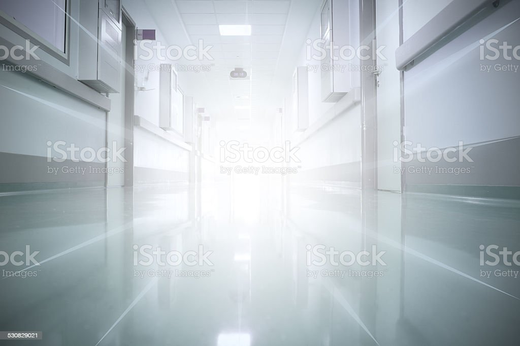light at the end of the corridor. The concept of life and death. stock photo