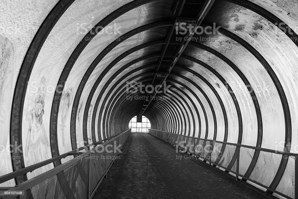 Light at the end of tunnel black and white. stock photo