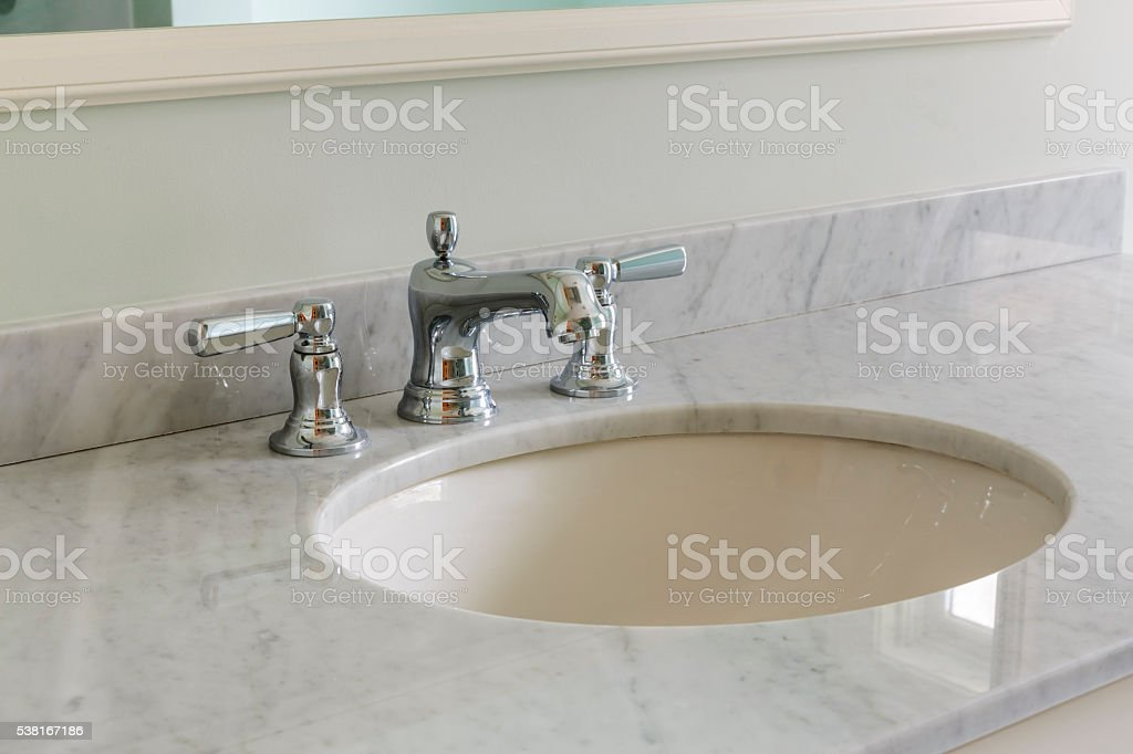 Light bathroom with marble counter top stock photo