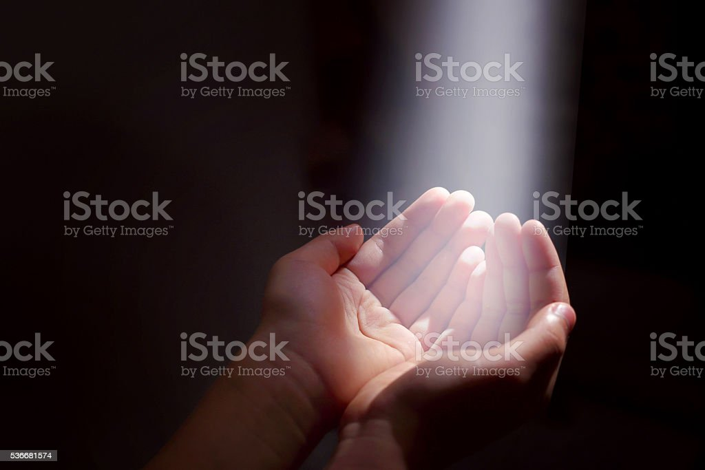 light beam and hands stock photo