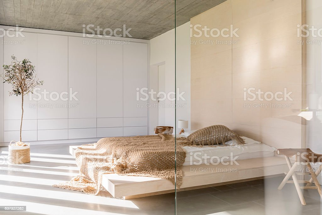Light bedroom with bed stock photo