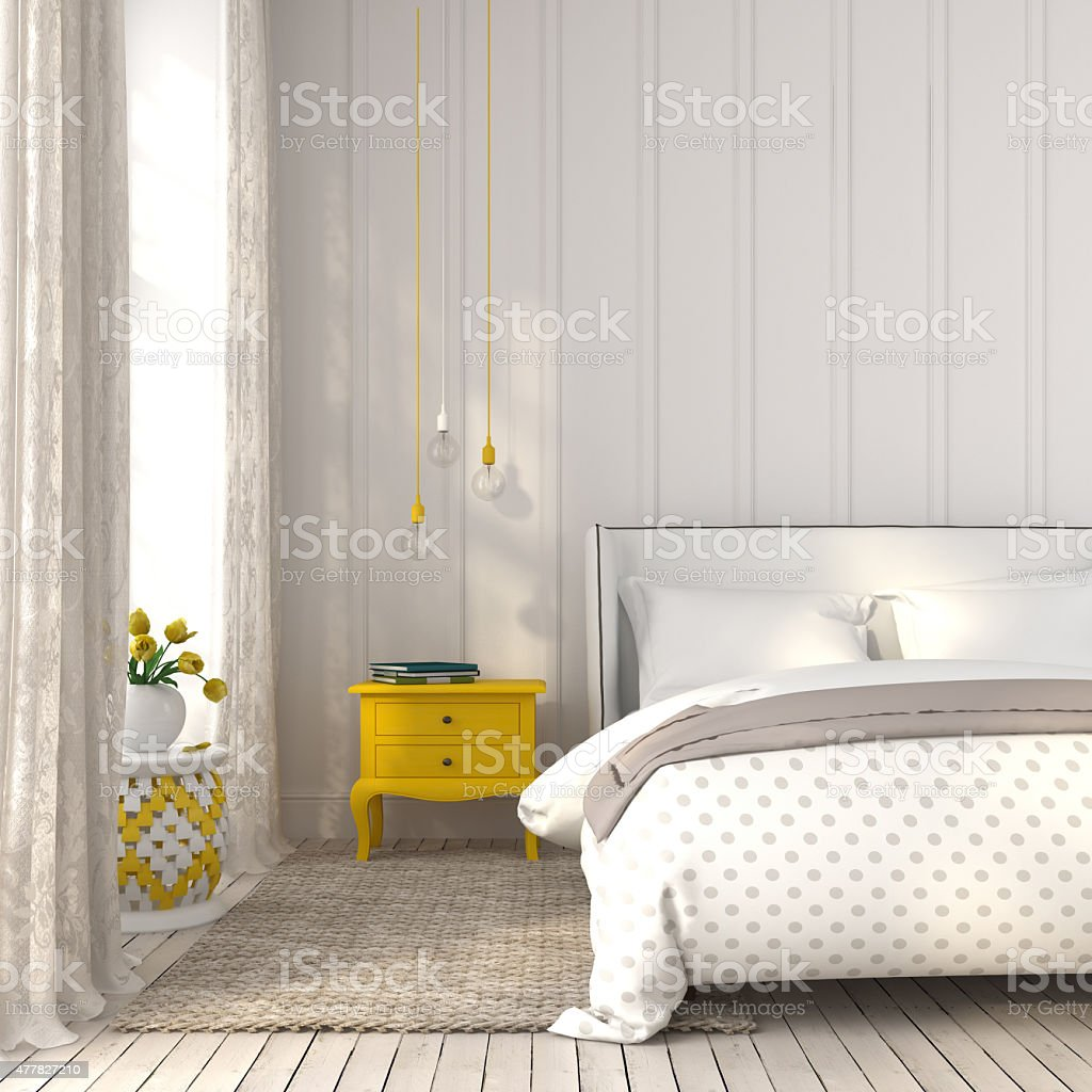 Light bedroom with yellow bedside table stock photo