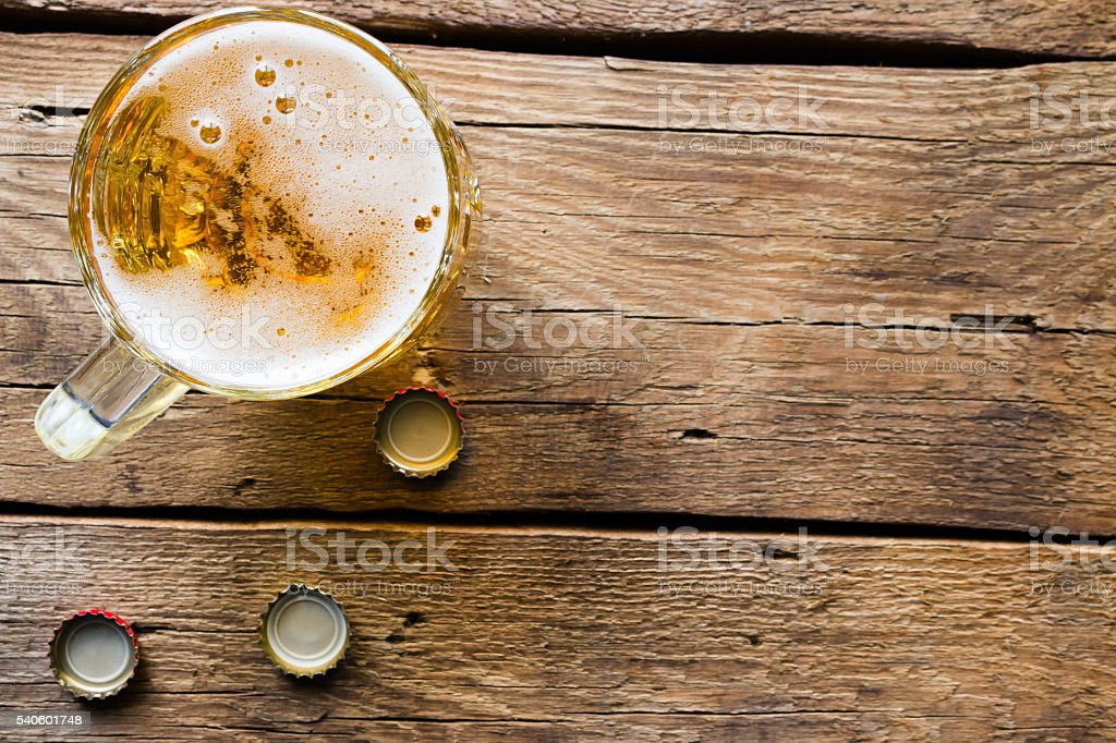 light beer mug on the wooden background stock photo