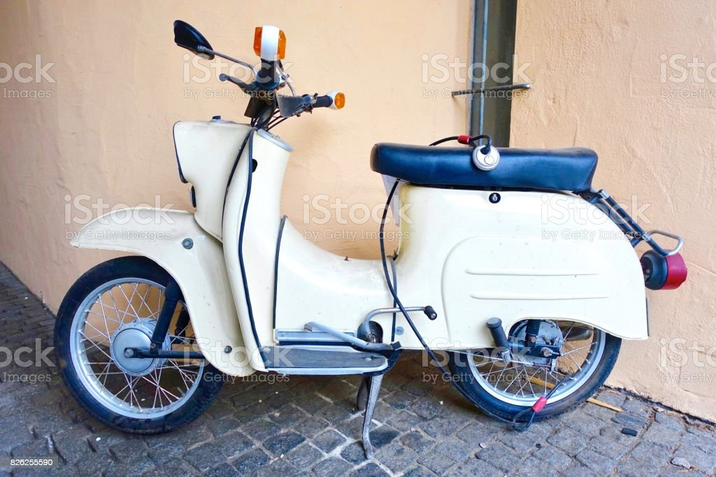 Light beige vintage scooter from the 60ies, German Democratic Republic stock photo