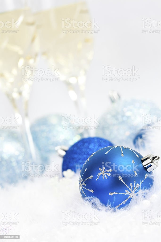 Light Blue Holiday Decoration Balls With Glasses of Champaign royalty-free stock photo