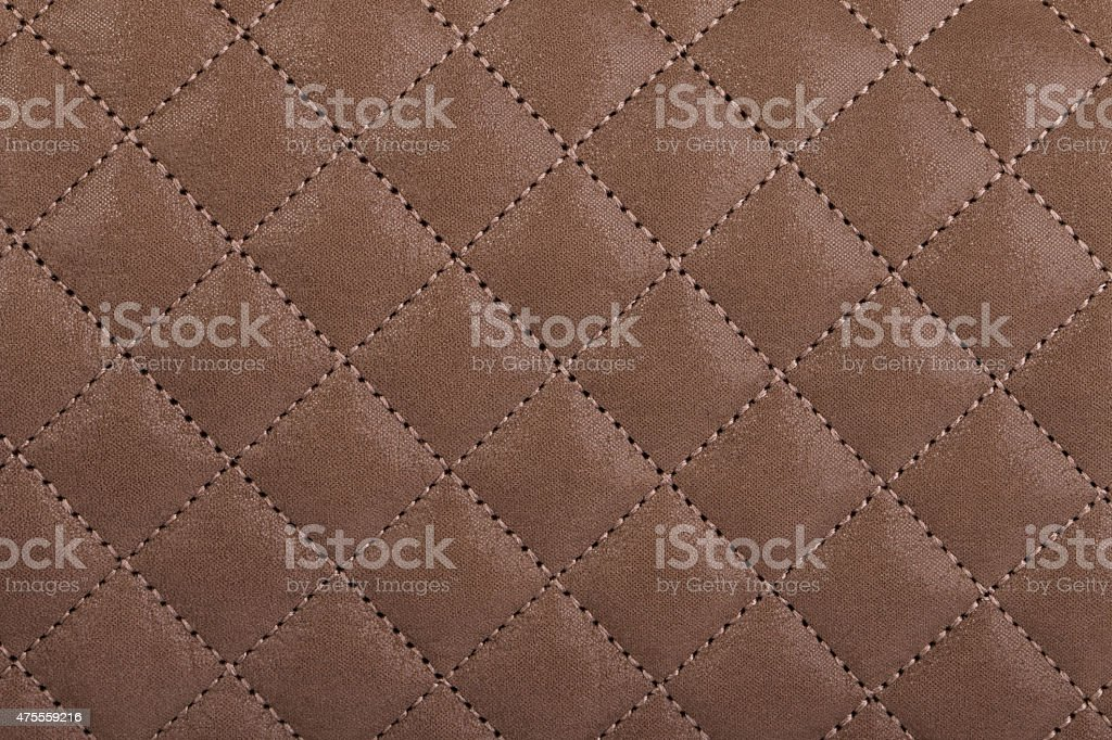 Light borwn quilted leather close-up stock photo