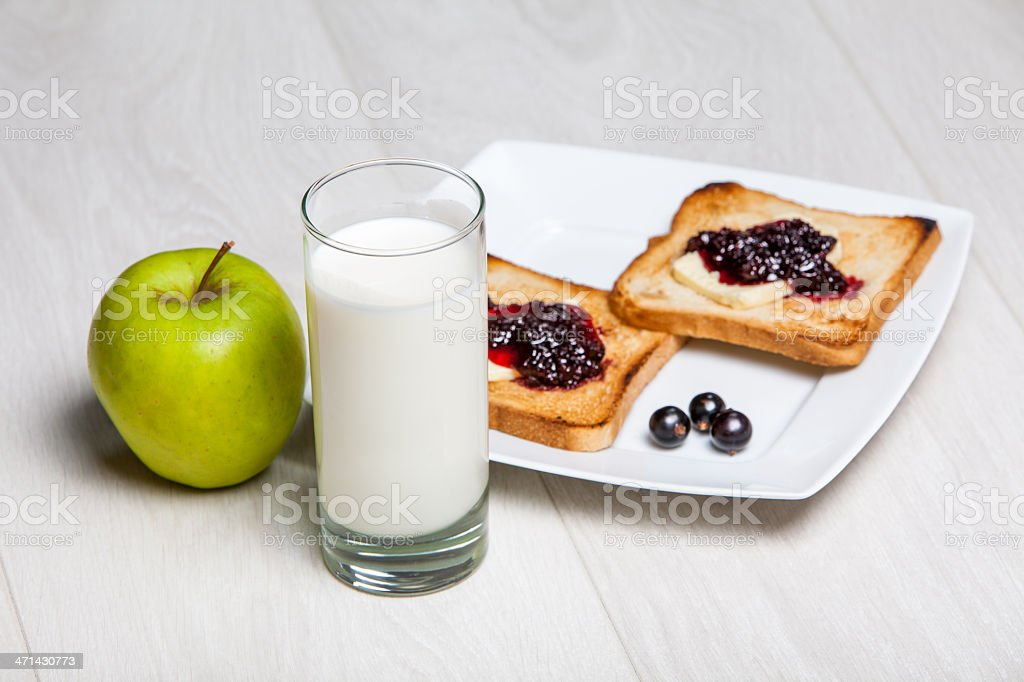light breakfast - milk and toasts with jam royalty-free stock photo