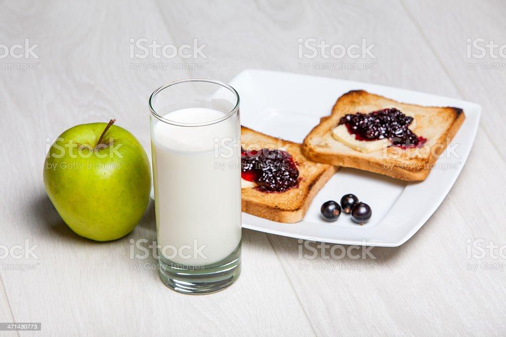 light breakfast - milk and toasts with jam stock photo